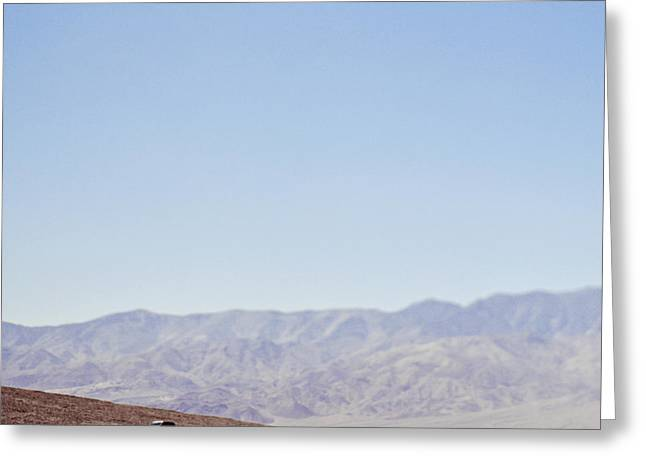 Scenic Drive Greeting Cards - Automobile Driving Through Desert Greeting Card by Eddy Joaquim