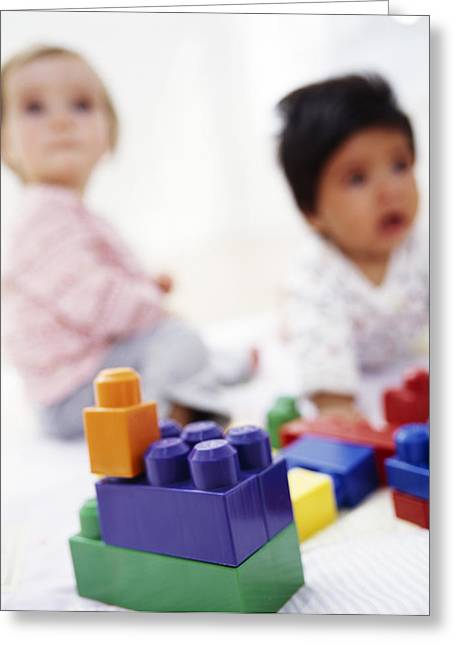 7 Months Greeting Cards - Babies With Building Blocks Greeting Card by Ian Boddy