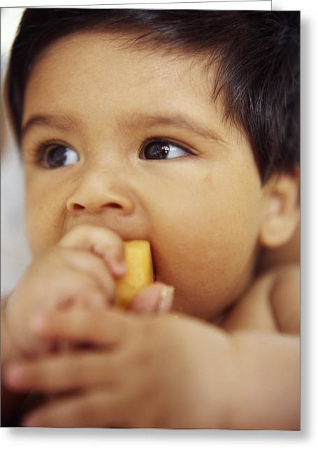 Baby Boy Eating Greeting Card by Ian Boddy