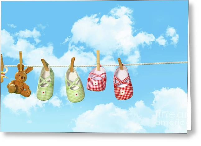 Baby Shoesr And Teddy Bear On Clothline Greeting Card by Sandra Cunningham