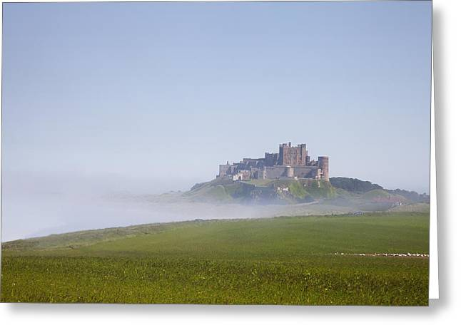 Foggy Day Greeting Cards - Bamburgh Castle On A Hill In The Fog Greeting Card by John Short