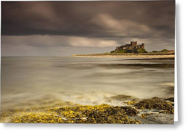 Ground Level Greeting Cards - Bamburgh Castle Under A Cloudy Sky Greeting Card by John Short