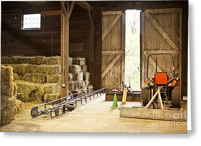 Hay Bales Photographs Greeting Cards - Barn with hay bales and farm equipment Greeting Card by Elena Elisseeva