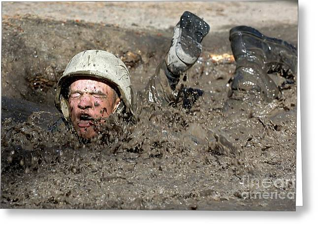 Plunging Greeting Cards - Basic Cadet Trainees Attack The Mud Pit Greeting Card by Stocktrek Images