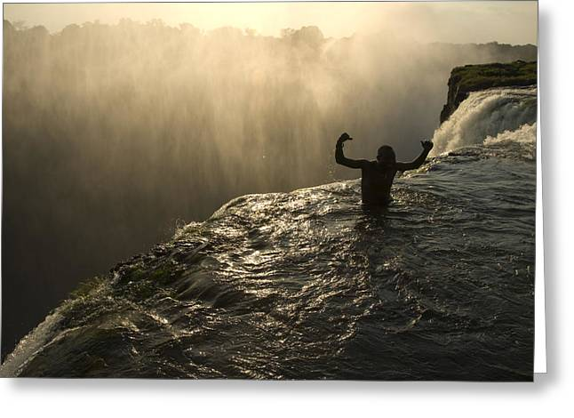 Zambia Waterfall Greeting Cards - Bathing In A Swimming Hole At The Top Greeting Card by Annie Griffiths