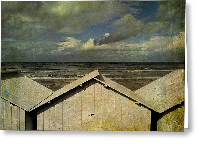 Overcast Day Greeting Cards - Beach huts under a stormy sky. vintage-look. Normandy. France Greeting Card by Bernard Jaubert