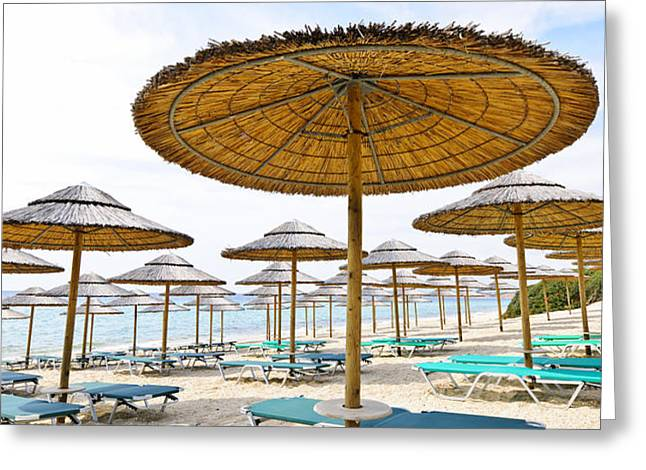 Beach umbrellas and chairs on sandy seashore Greeting Card by Elena Elisseeva