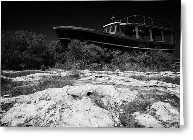 Fishing Creek Greeting Cards - Beached Abandoned Fishing Boat In Potamos Typical Small Unspoilt Fishing Village Cyprus Greeting Card by Joe Fox