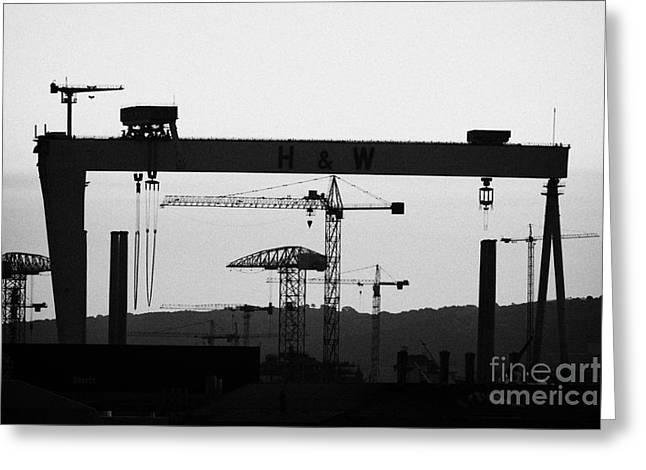 Wolff Greeting Cards - Belfast Shipyard Cranes Skyline Evening Harland Wolff Greeting Card by Joe Fox
