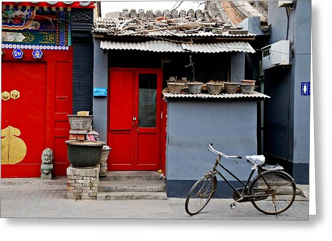 Bicycle And Red Door Greeting Card by Dean Harte