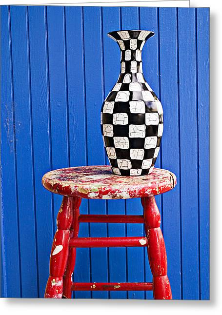 Old Vase Greeting Cards - Blach and white vase on stool against blue wall Greeting Card by Garry Gay