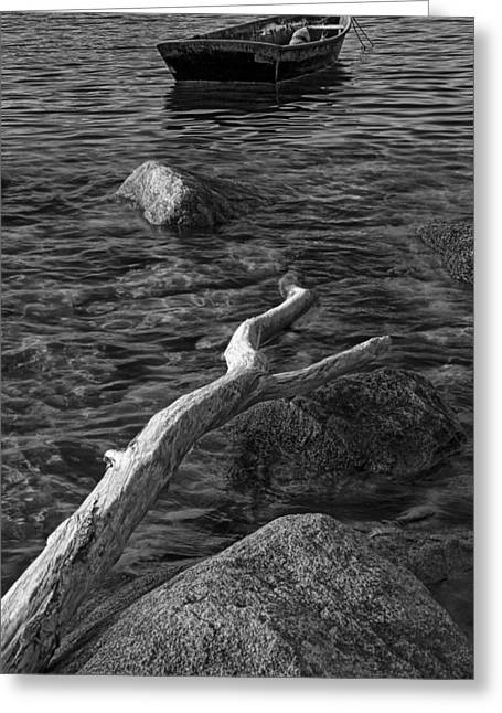 Row Boat Greeting Cards - Black and White Photograph of a row boat anchored near a rocky shore Greeting Card by Randall Nyhof