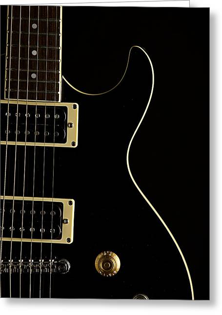 Guitar Pictures Greeting Cards - Black Electric Guitar on Dark Background Greeting Card by M K  Miller