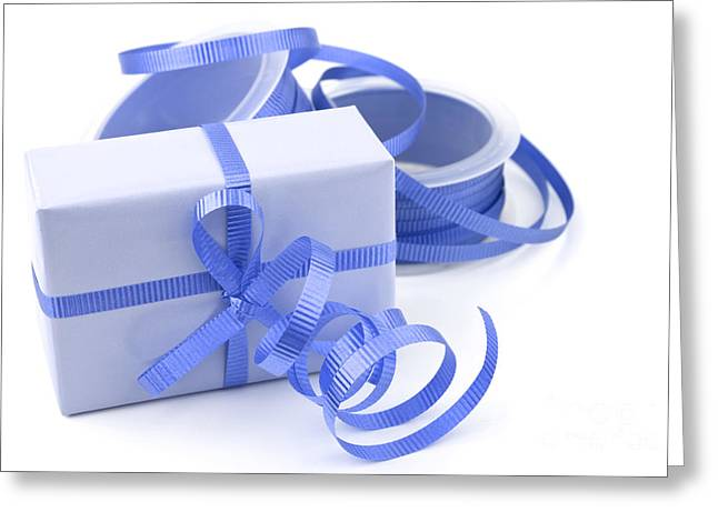 Streamer Greeting Cards - Blue gift Greeting Card by Blink Images