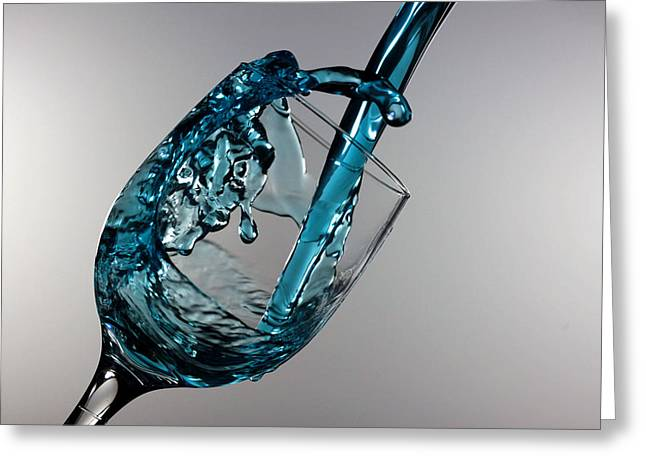 Wine Pour Greeting Cards - Blue Martini splashing from a wine glass Greeting Card by Paul Ge