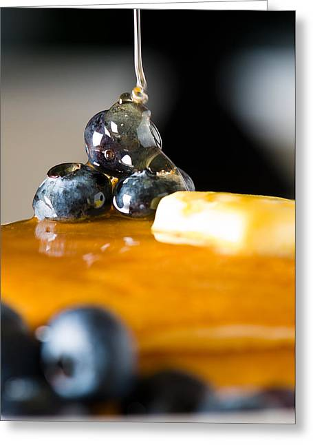 Maple Syrup Greeting Cards - Blueberry butter pancake with honey maple sirup flowing down Greeting Card by Ulrich Schade