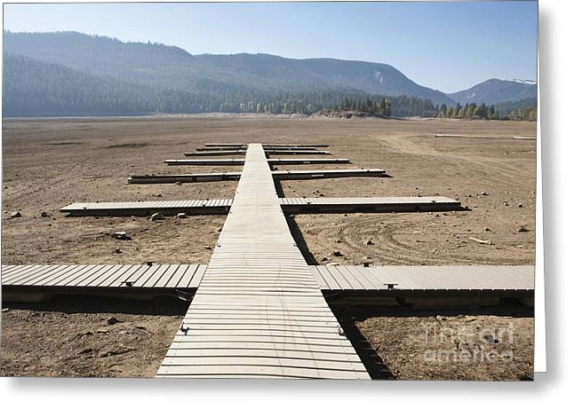 Dry Lake Greeting Cards - Boat Dock on Dry Lakebed Greeting Card by Paul Edmondson