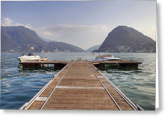 Docked Boat Greeting Cards - Boat dock on Lake Lugano Greeting Card by Joana Kruse
