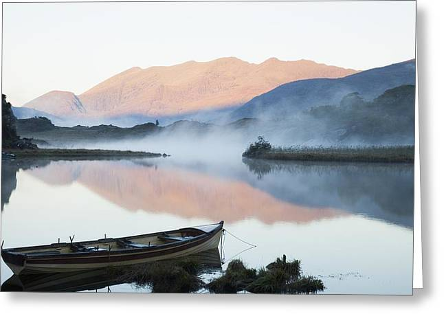 Row Boat Greeting Cards - Boat On A Tranquil Lake Killarney Greeting Card by Peter Zoeller