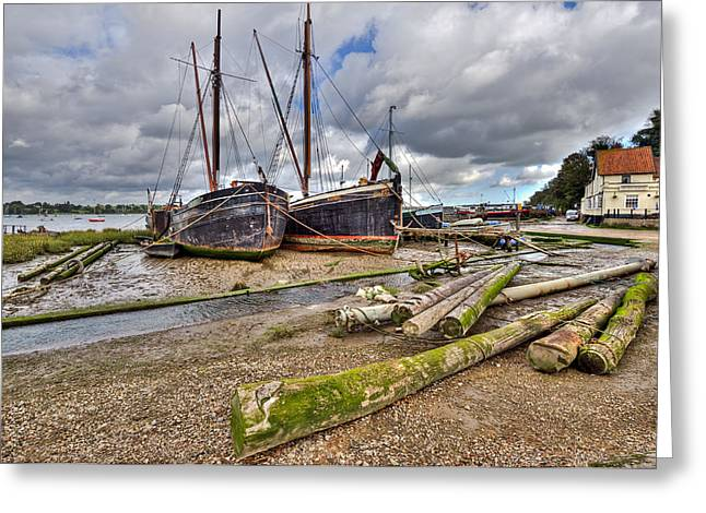 Working Boats Greeting Cards - Boats and logs at Pin Mill Greeting Card by Gary Eason