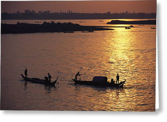 River Of Life Greeting Cards - Boats Silhouetted On The Mekong River Greeting Card by Steve Raymer