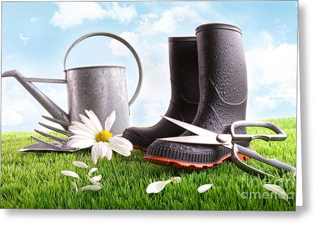 Gardening Greeting Cards - Boots with watering can and daisy in grass  Greeting Card by Sandra Cunningham