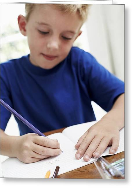 Child Care Greeting Cards - Boy Drawing In An Exercise Book Greeting Card by Ian Boddy