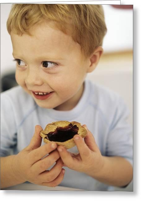 Boy Eating A Jam Tart Greeting Card by Ian Boddy
