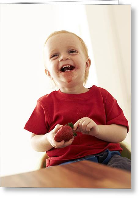 Kid Eating Snack Greeting Cards - Boy Eating A Strawberry Greeting Card by Ian Boddy