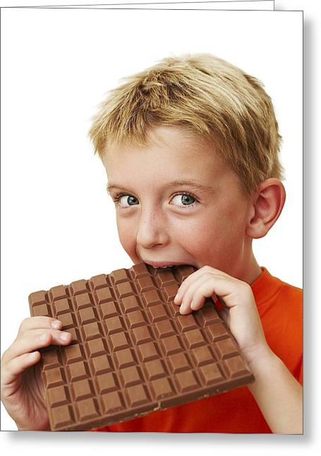 Eating Disorders Greeting Cards - Boy Eating Chocolate Greeting Card by Ian Boddy
