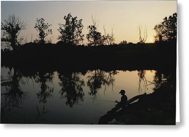 Refuges And Reserves Greeting Cards - Boy Fishing At Twilight.  Black Hills Greeting Card by Brian Gordon Green