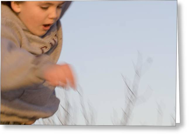 Boy jumping off sand dune Greeting Card by Christopher Purcell