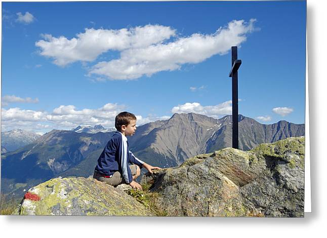 Swiss Cross Greeting Cards - Boy on mountain top looking at cross Greeting Card by Matthias Hauser