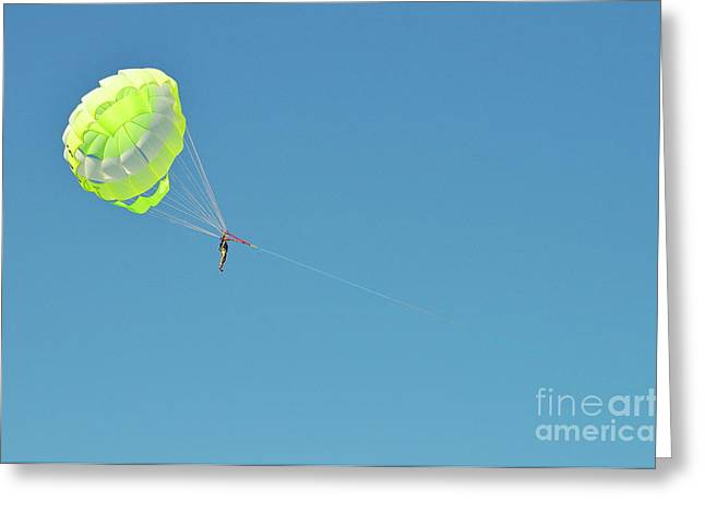 Getting Air Greeting Cards - Boy parascending in the sky Greeting Card by Sami Sarkis