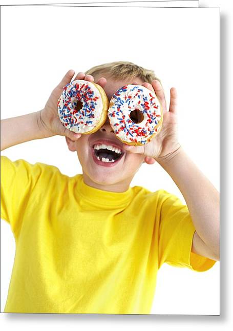 Doughnuts Greeting Cards - Boy Playing With Doughnuts Greeting Card by Ian Boddy