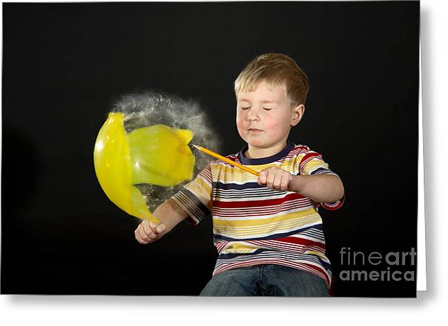 Human Being Photographs Greeting Cards - Boy Popping A Balloon Greeting Card by Ted Kinsman