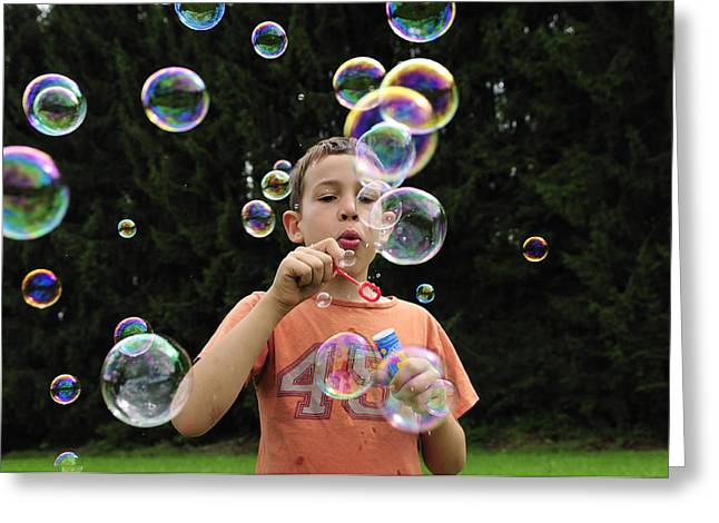 Boy with colorful bubbles Greeting Card by Matthias Hauser