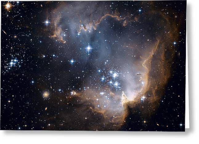 Magellanic Greeting Cards - Bright Blue Newborn Stars Blast A Hole Greeting Card by ESA and nASA