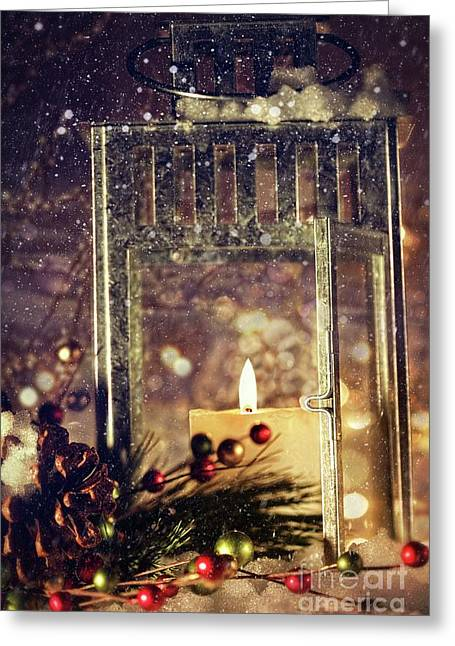Snowy Evening Greeting Cards - Brightly lit lantern in the snow Greeting Card by Sandra Cunningham