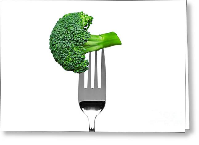 Broccoli Photographs Greeting Cards - Broccoli on a fork isolated on white Greeting Card by Richard Thomas