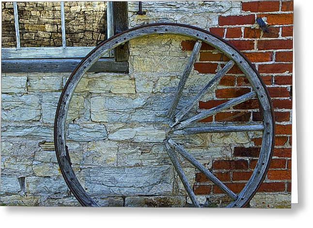 Wagon Wheels Greeting Cards - Broken Wagon Wheel against the wall Greeting Card by Randall Nyhof