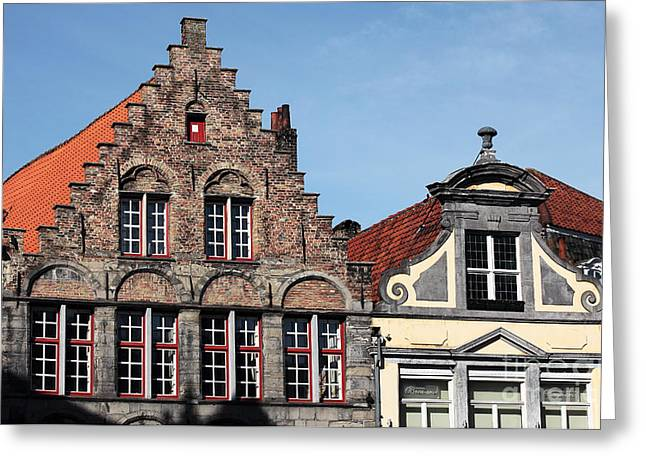 Medieval Buildings Greeting Cards - Building Tops in Bruges Greeting Card by John Rizzuto