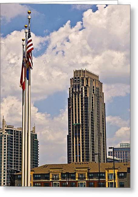 Susan Leggett Greeting Cards - Buildings and Flags Against Sky Greeting Card by Susan Leggett