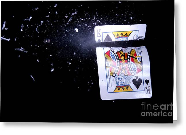 Playing Cards Photographs Greeting Cards - Bullet Hitting A Playing Card Greeting Card by Ted Kinsman