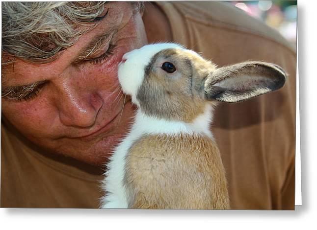 Bunny Kisses Greeting Card by Theresa Johnson