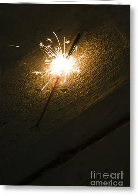 Beach At Night Greeting Cards - Burning Sparkler On Sidewalk At Night Greeting Card by Roberto Westbrook