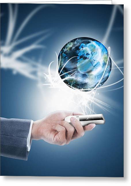 Businessman Holding Mobile Phone With Globe Greeting Card by Setsiri Silapasuwanchai