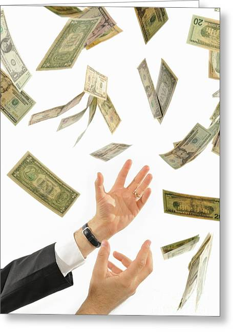 Businessman's Hands Trying To Catch Us Dollars Greeting Card by Sami Sarkis