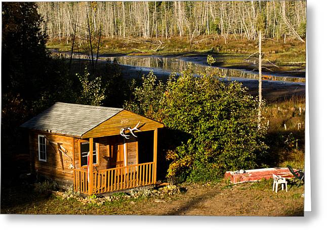 Cabins Photographs Greeting Cards - Cabin on the River Greeting Card by Cale Best