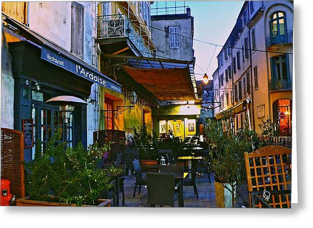 Cafe Terrace On The Place Du Forum Greeting Card by Eric Tressler
